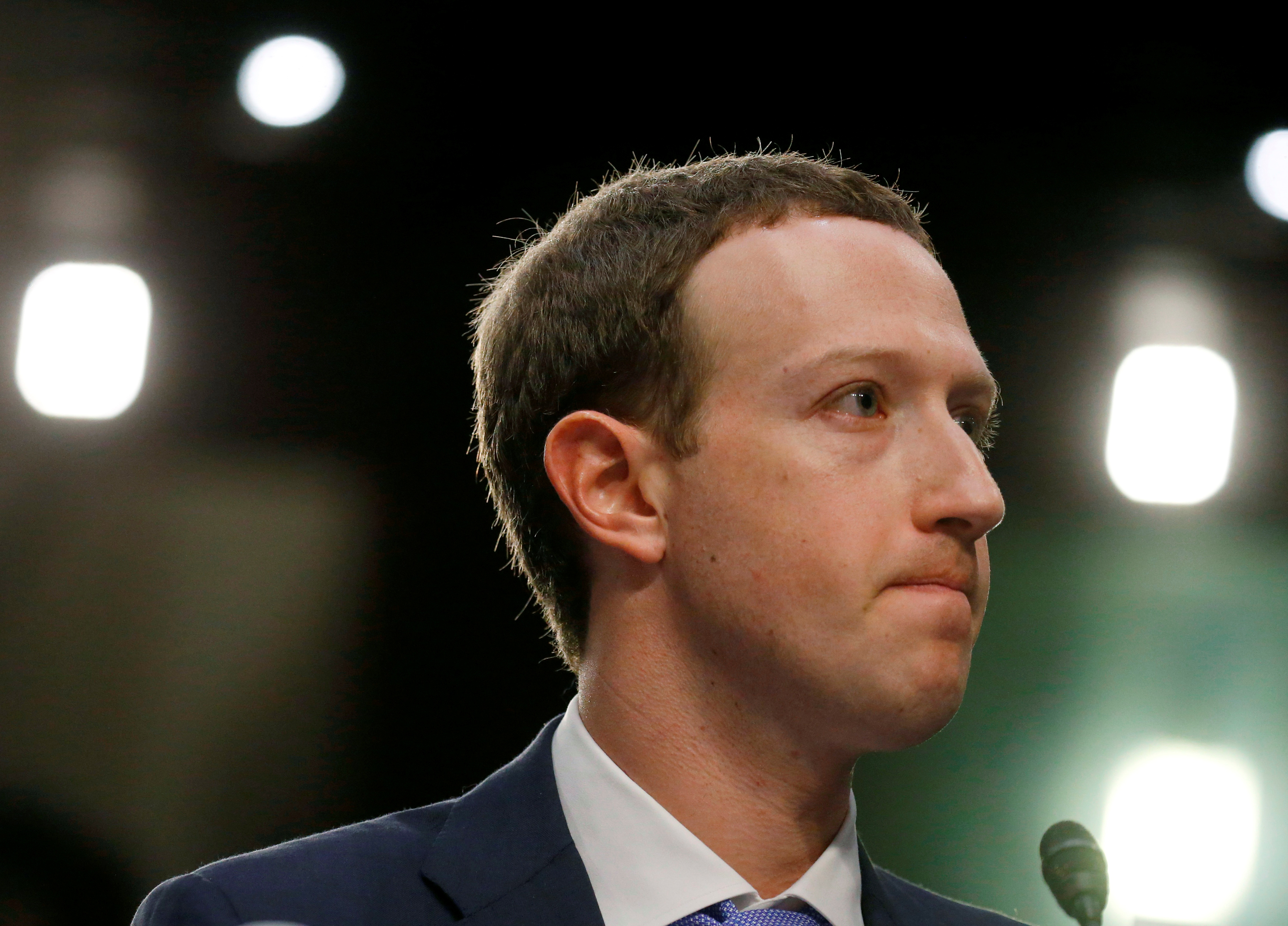 Facebook CEO Mark Zuckerberg listens while testifying before a joint Senate