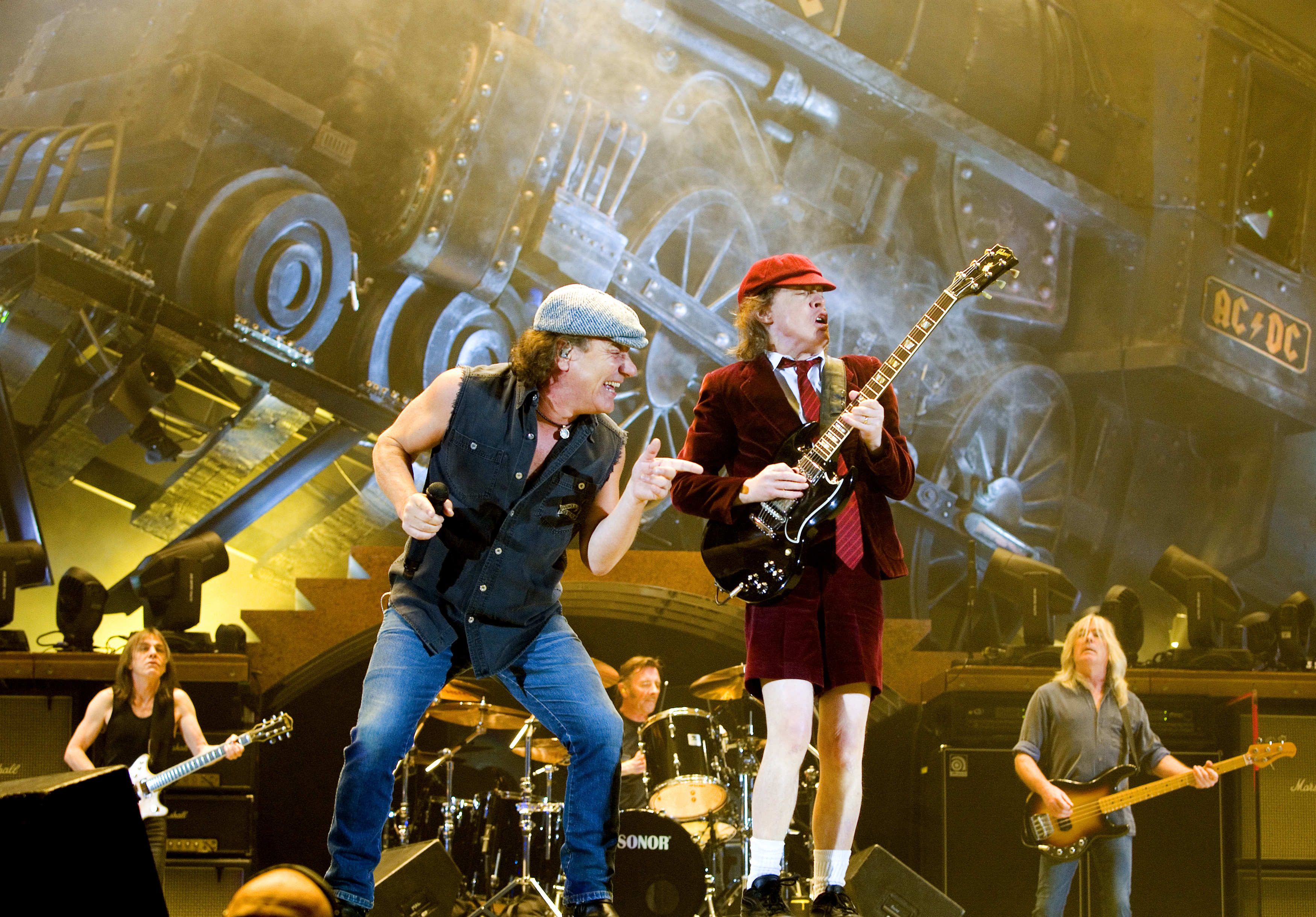 Rock band AC/DC lead guitarist Angus Young (R) and vocalist Brian Johnson perform during a concert at the Telenor Arena in Fornebu, near Oslo February 18, 2009.