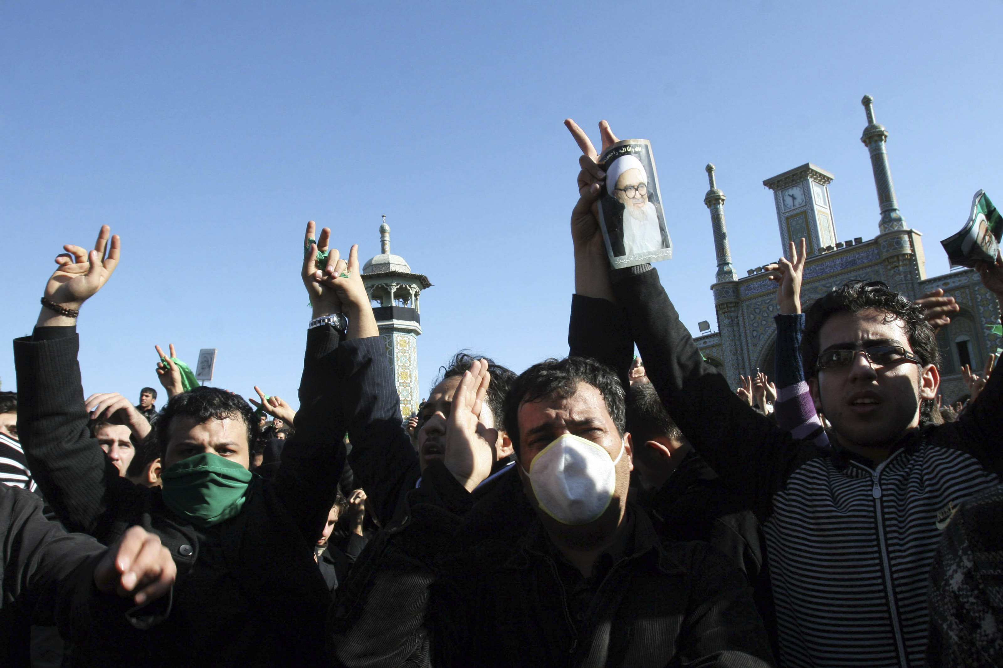 People wear green bands in support of the Iranian opposition movement during the funeral of dissident Iranian cleric Grand Ayatollah Hossein Ali Montazeri in the holy city of Qom on December 21, 2009.