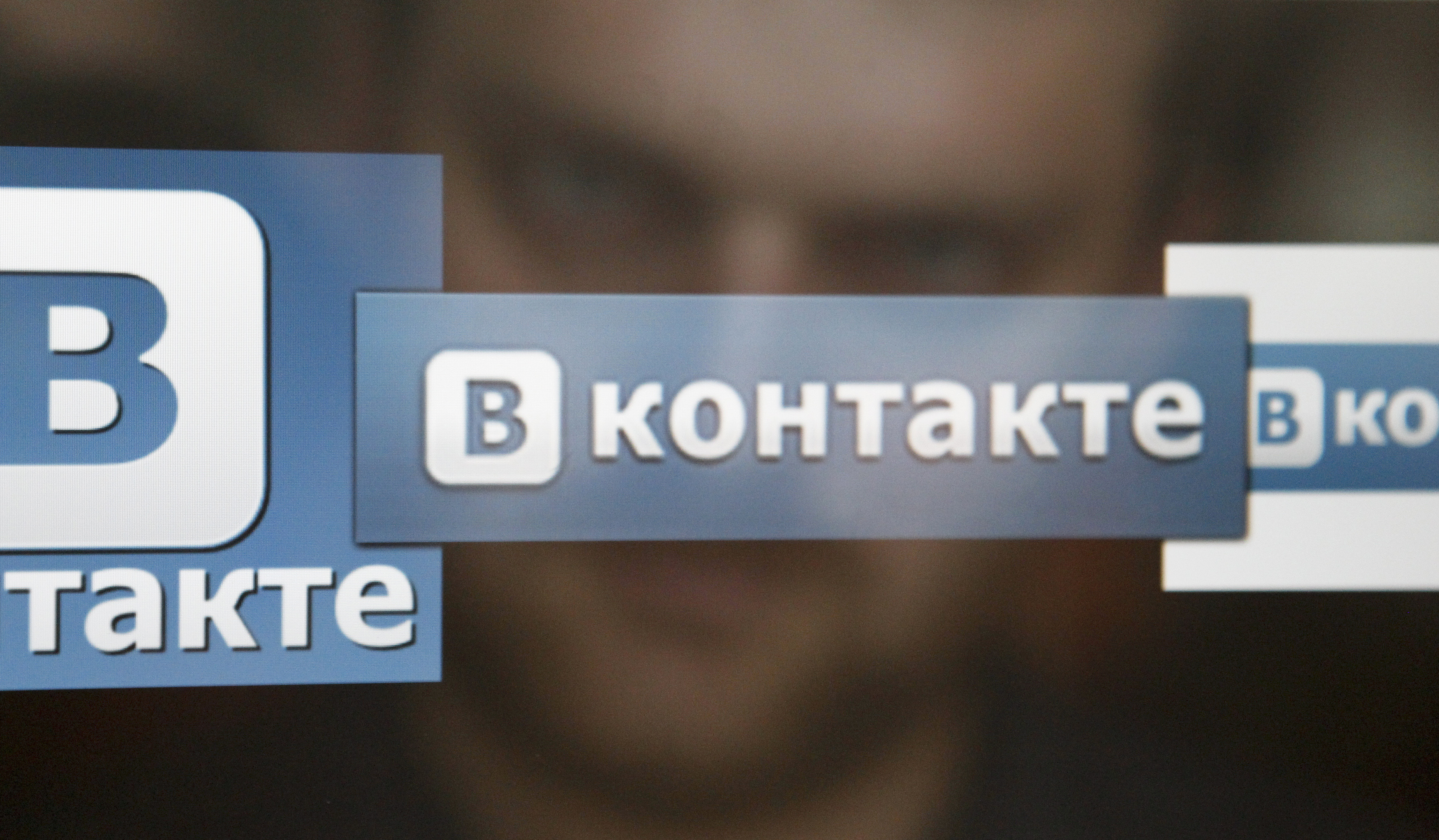 A man looks at a computer screen showing logos of Russian social network VKontakte in an office in Moscow.