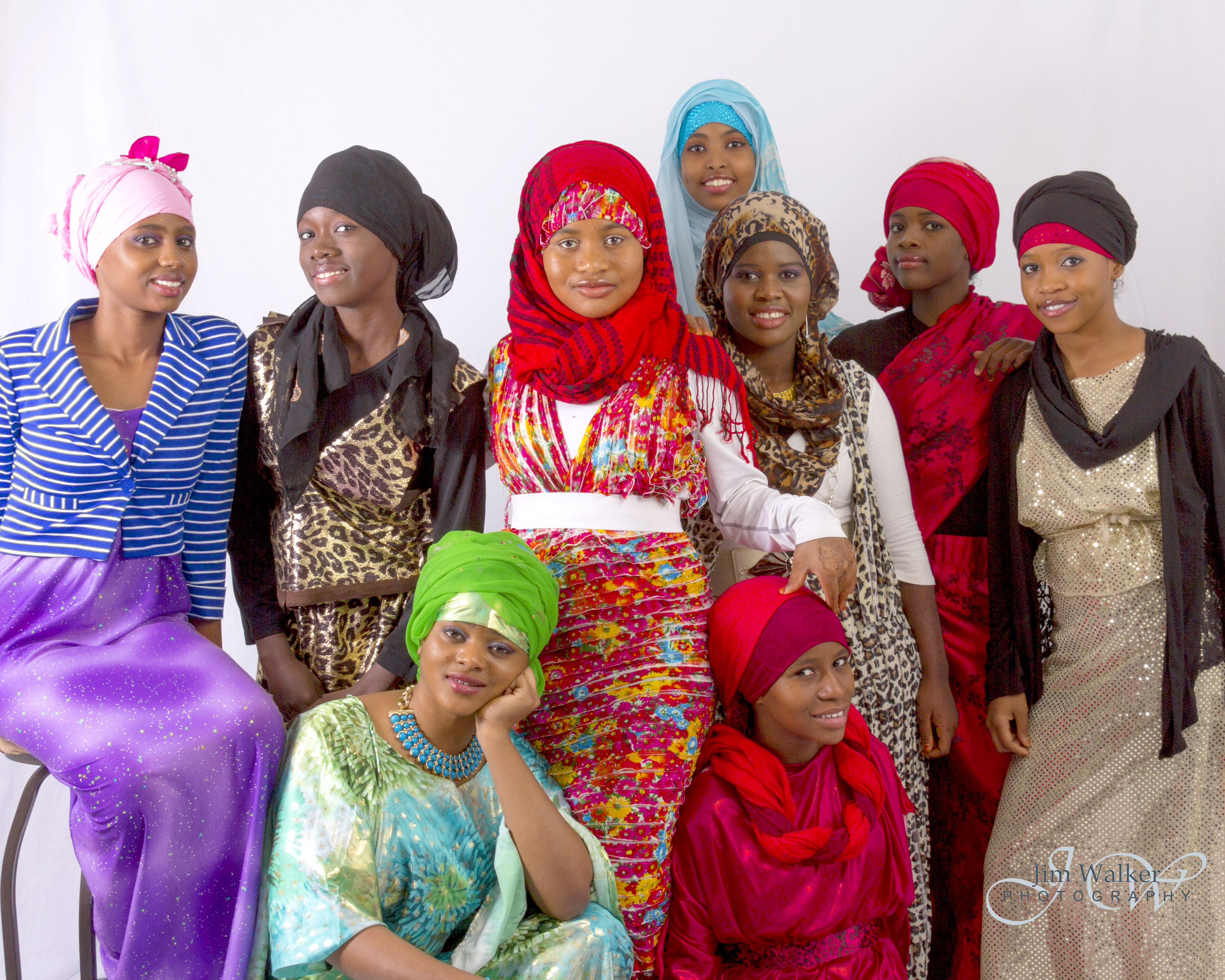 Sahro Hassan (center) surrounded by friends and family modeling her designs.