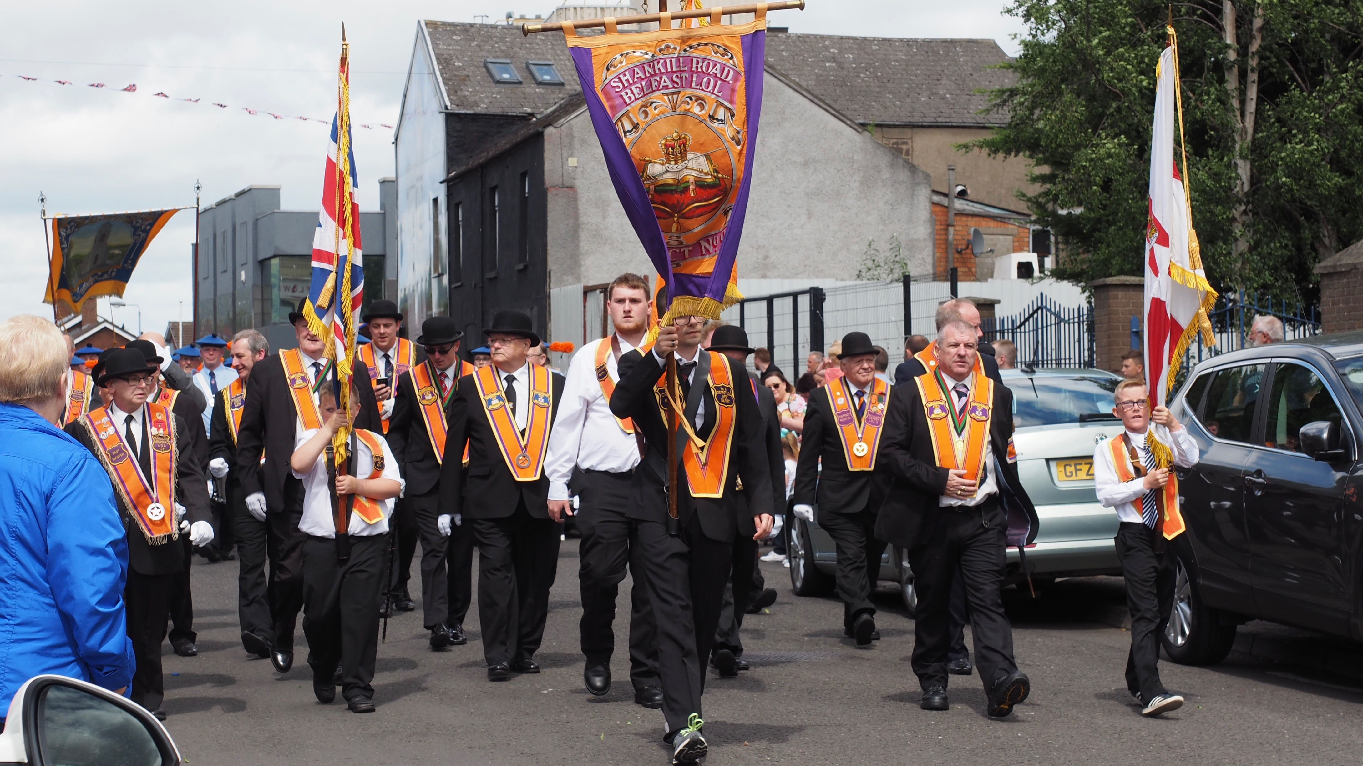 Orangemen march down Conway Street, off Shankill Road, in Belfast.