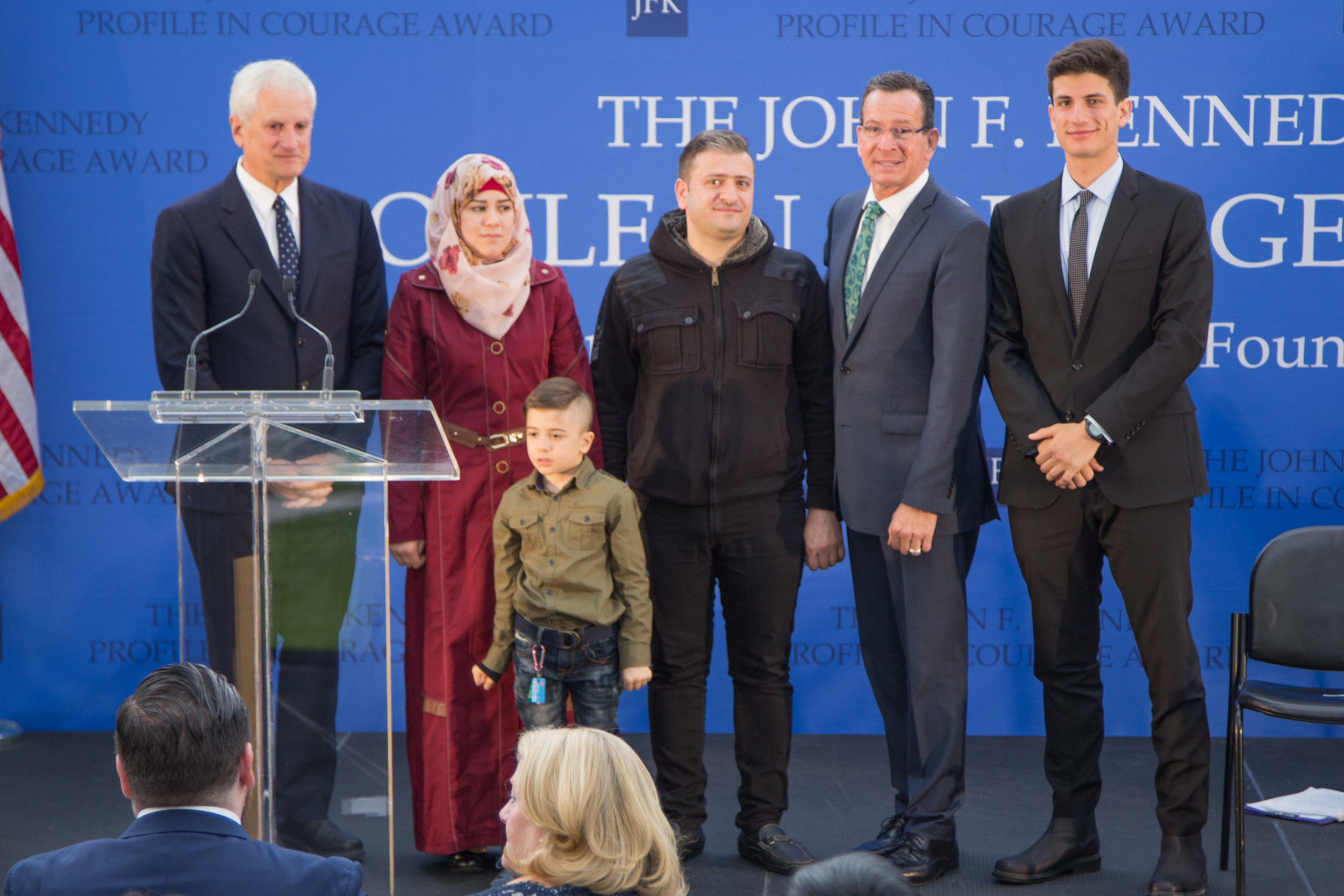 This Syrian couple and their 5 year old son lauded Gov. Dannel Malloy (second from right) for personally welcoming them to Indiana last November. The family is withholding their last name due to concerns about the safety of relatives back in Syria.