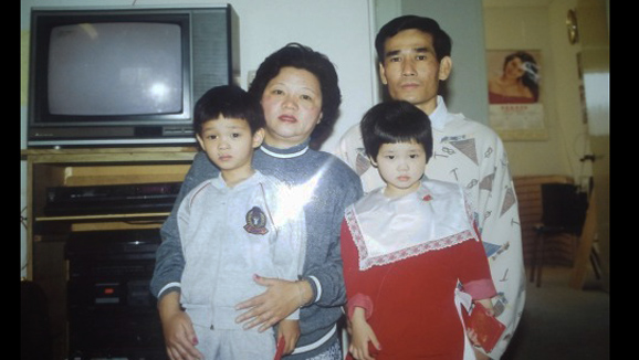 A photo of Tam Duong's family during Lunar New Year in the early 1990s. Tam, on the right in the red dress, is from Los Angeles and now lives in Boston. Her parents are from Vietnam and Duong says she was confused as to why Santa never came to their home.