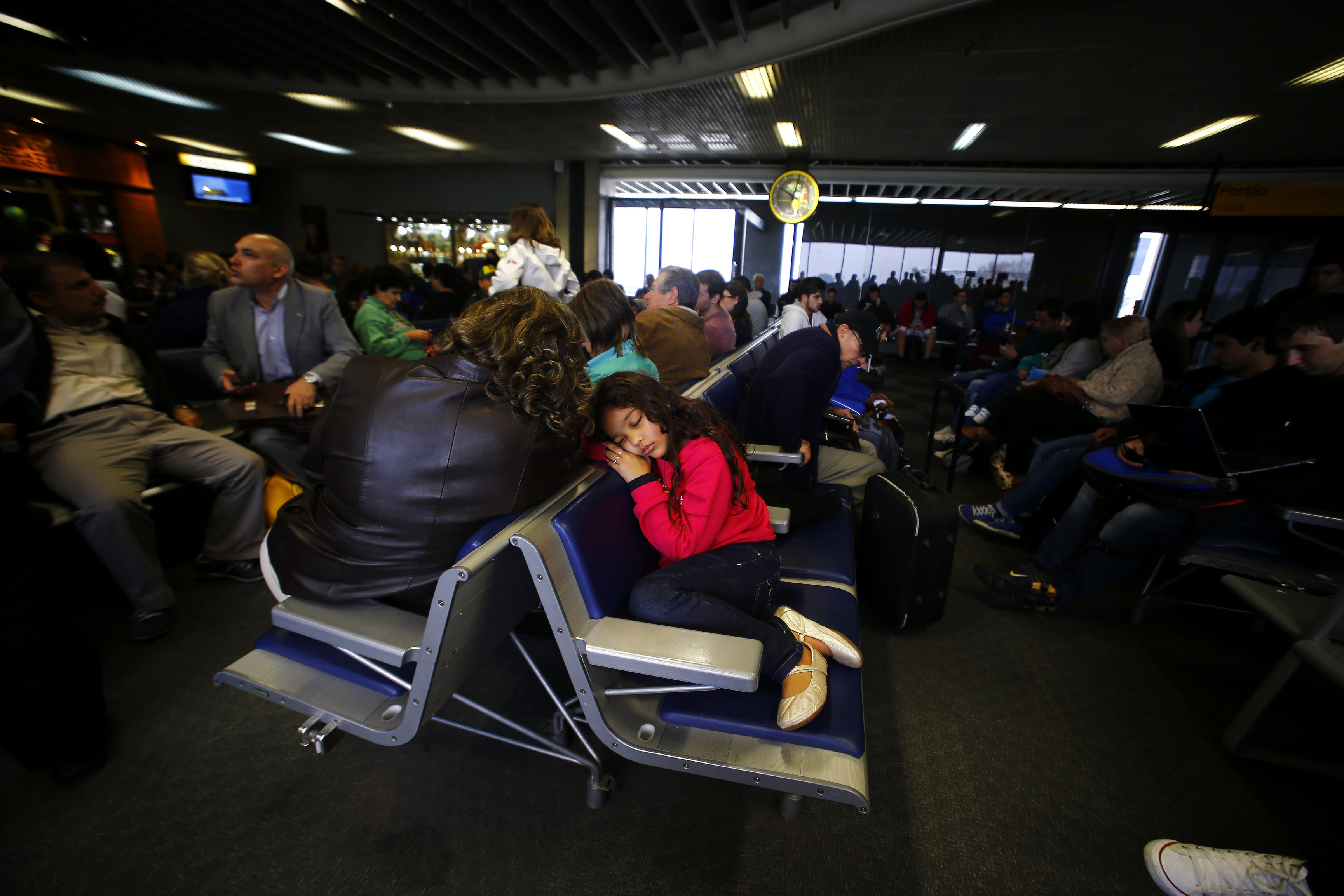 Passengers wait for their delayed flights at Alfonso Pena airport in Curitiba city.