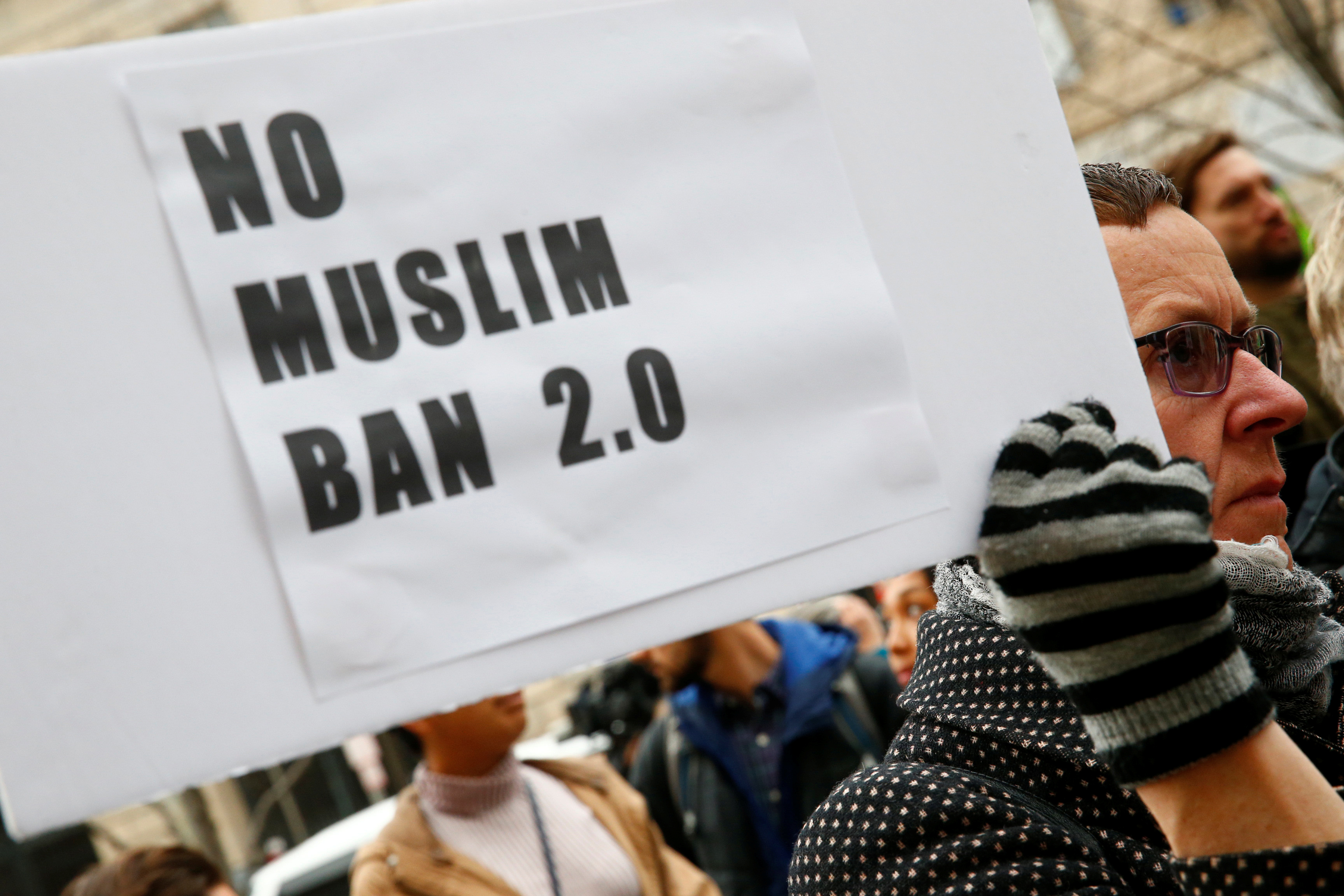 Immigration activists rally against the Trump administration's new ban against travelers from six Muslim-majority nations