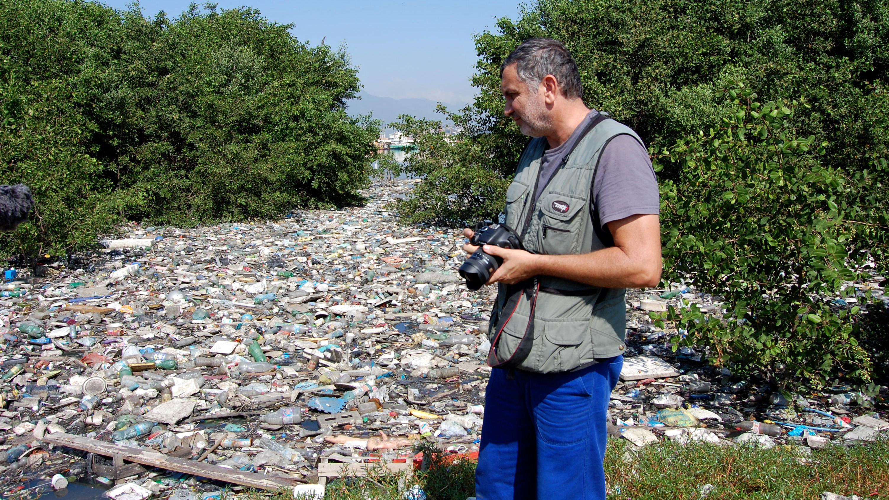 Biologist Mario Moscatelli along the shores of Guanabara Bay in Rio