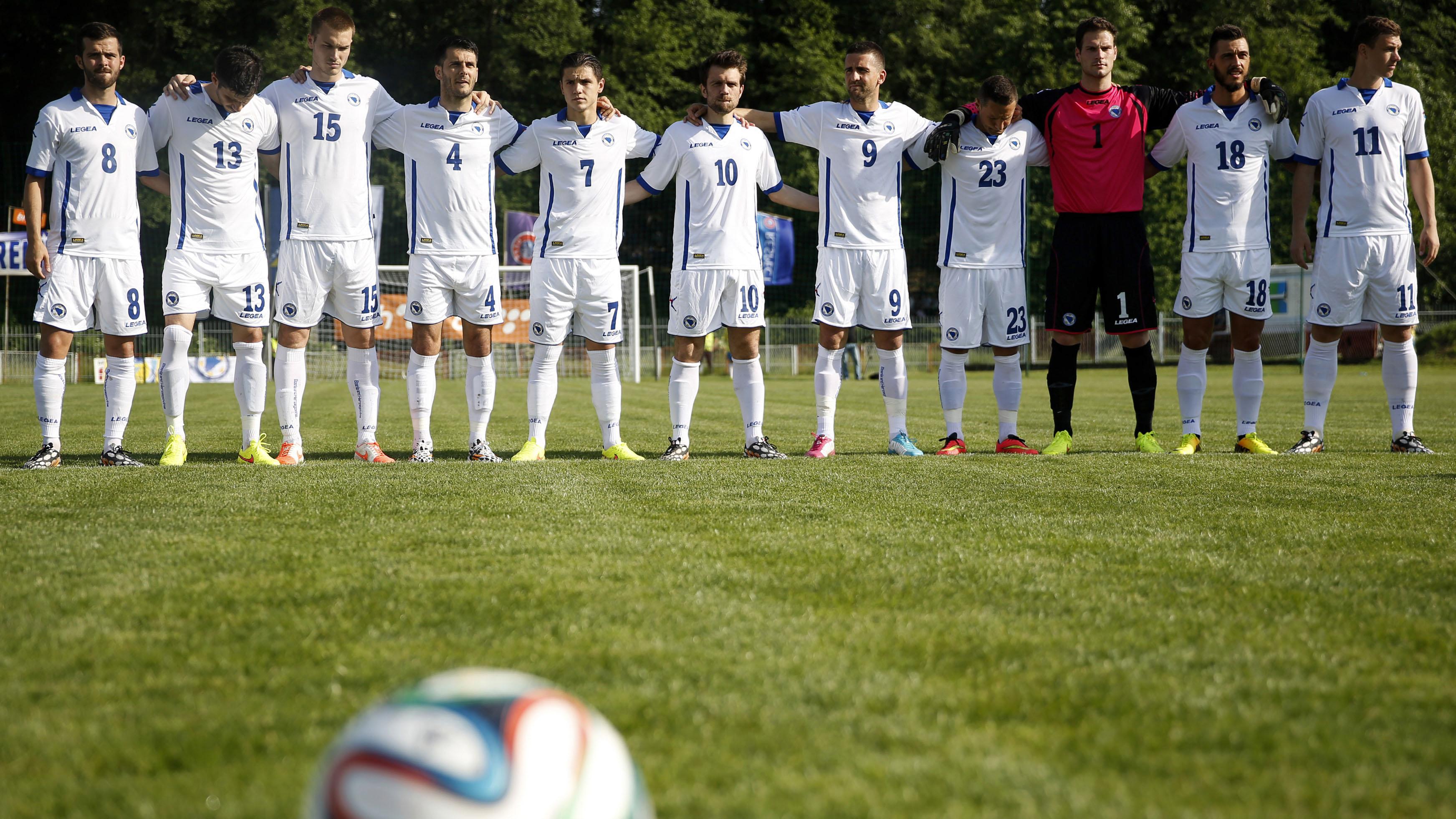 Bosnia's national soccer team players (L-R) Miralem Pjanic, Jasmin Mujdza, Toni Sunjic, Emir Spahic, Tino-Sven Susic, Zvjezdan Misimovic, Vedad Ibisevic, Sejad Salihovic, Asmir Begovic, Haris Medunjanin and Edin Dzeko