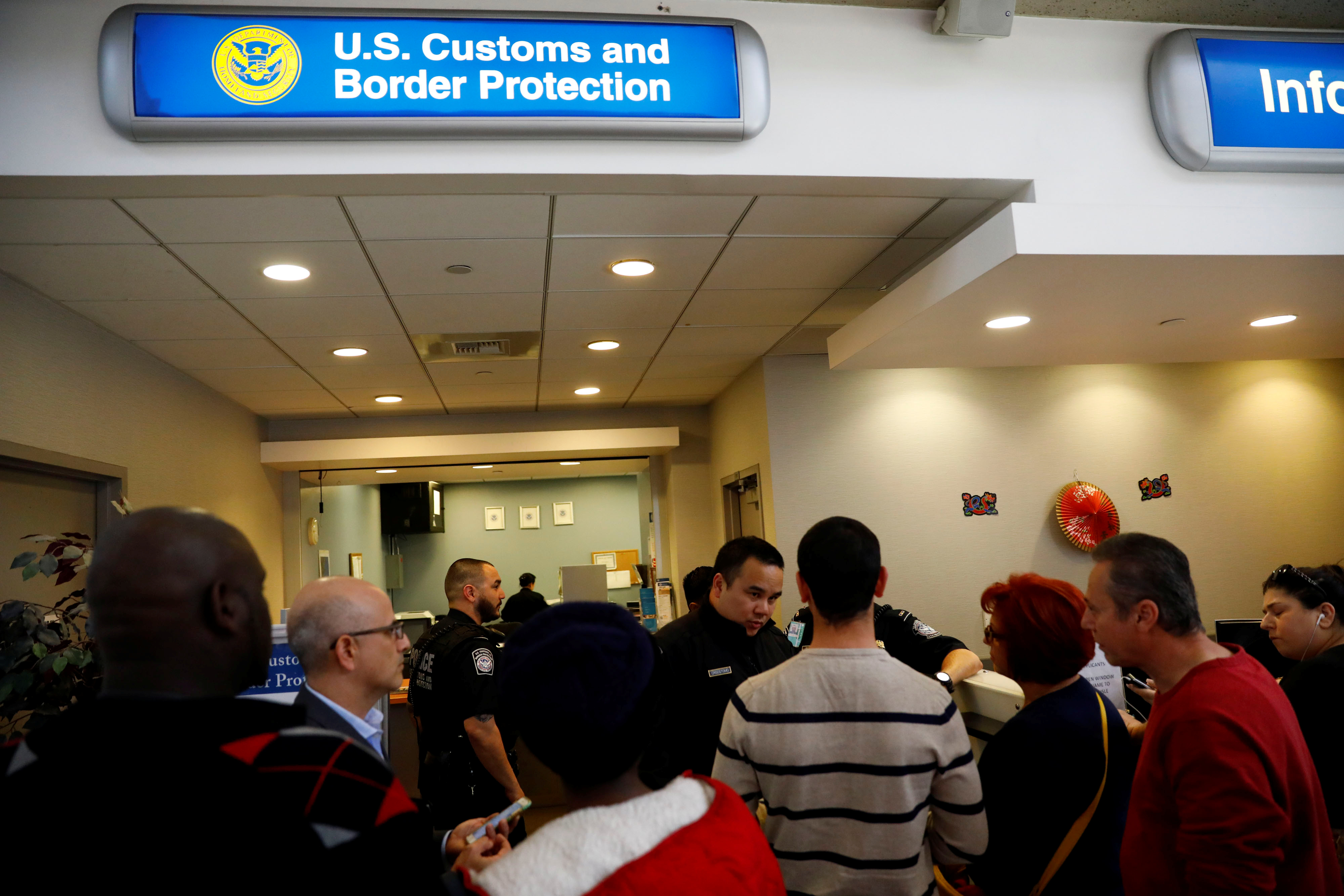 US Customs and Border Protection officers stand outside an office