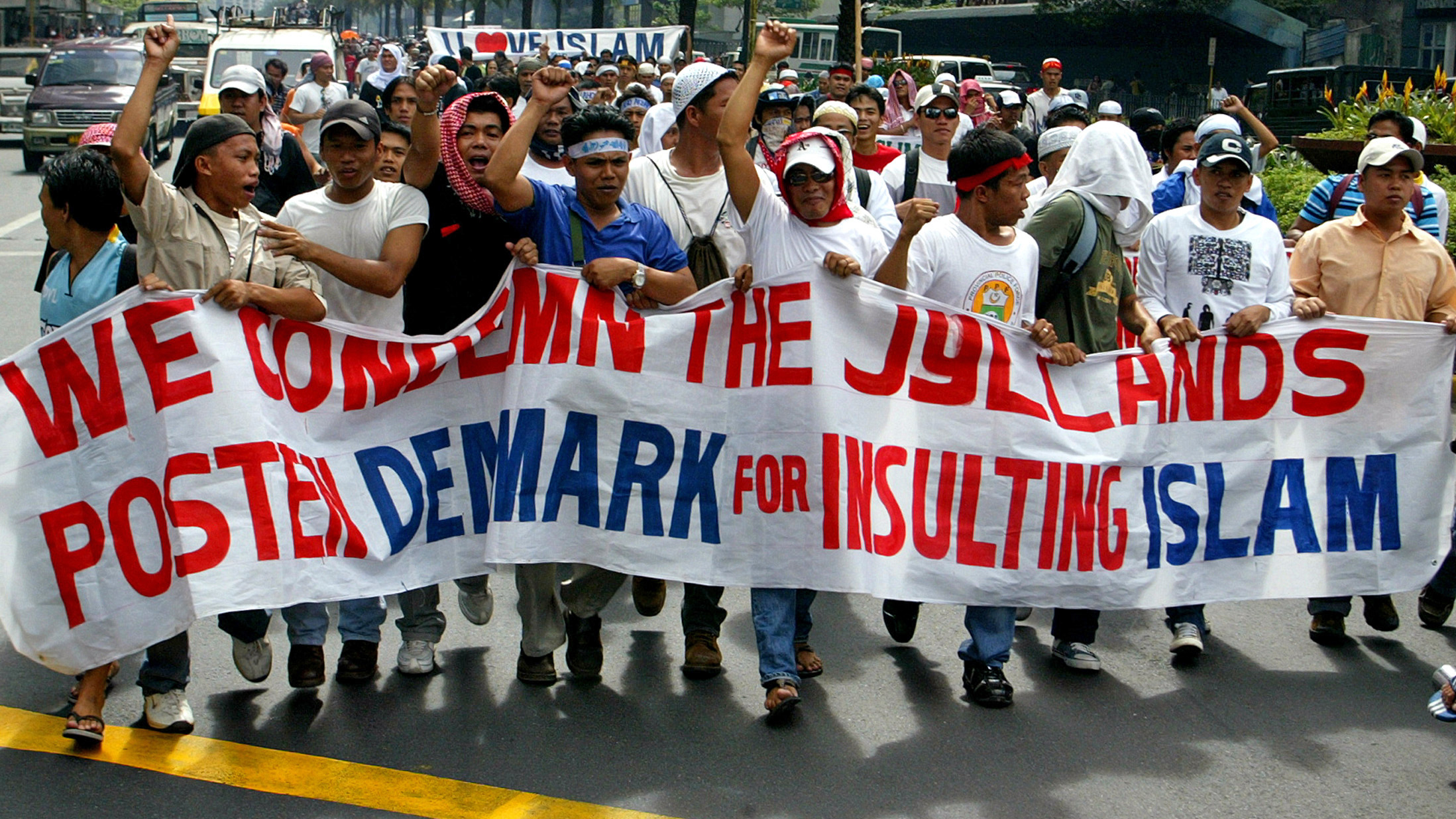 Filipino Muslims hold a banner during a rally outside the Danish embassy in Manila's Makati financial district February 15, 2006. The protesters were demonstrating against cartoons depicting the Prophet Mohammad that were published by a Danish newspaper.