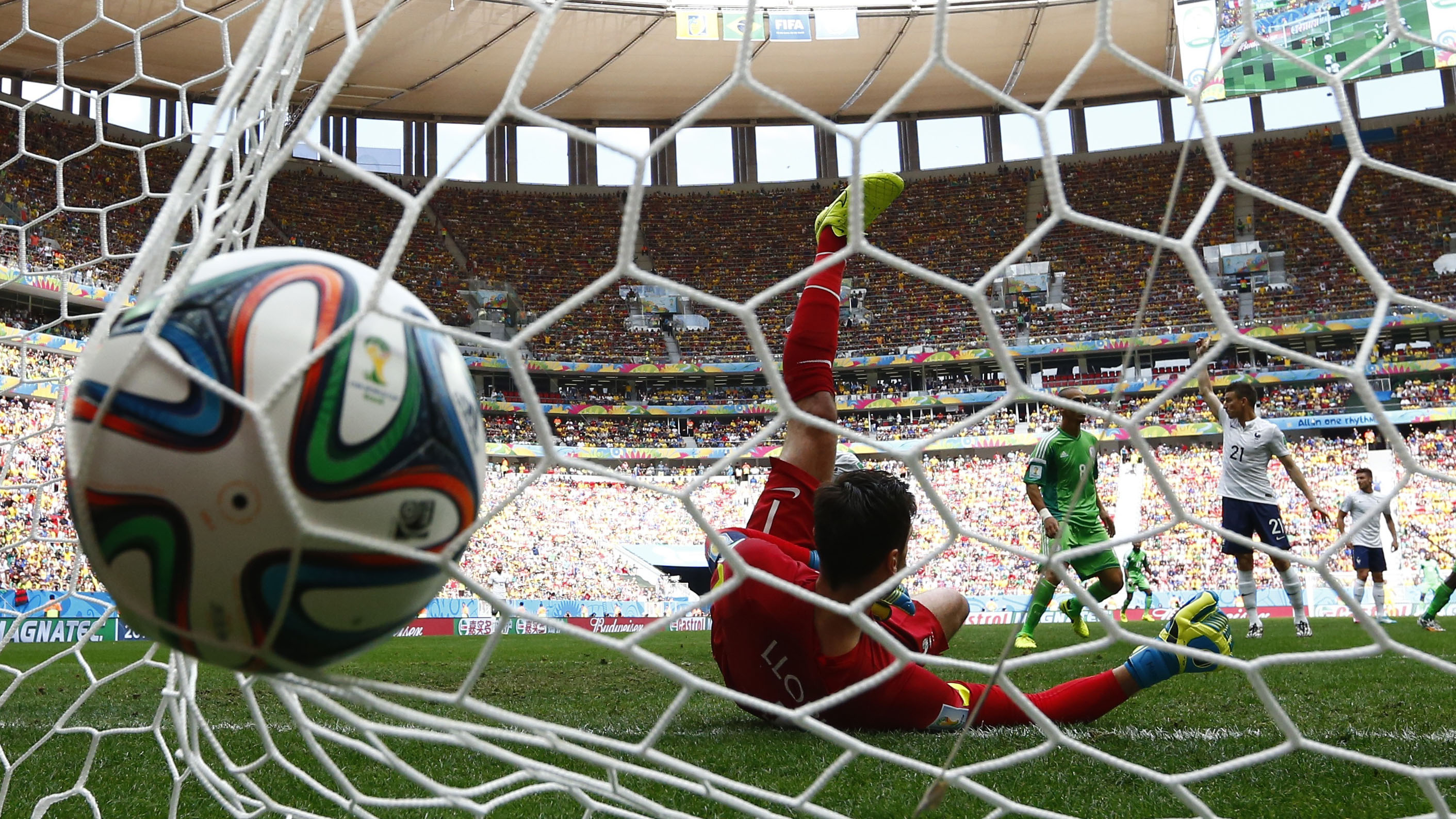 France's goalkeeper Hugo Lloris fails to stop a goal shot by Nigeria's Emmanuel Emenike, which was later disallowed, during their 2014 World Cup round of 16 game at the Brasilia national stadium in Brasilia June 30, 2014.