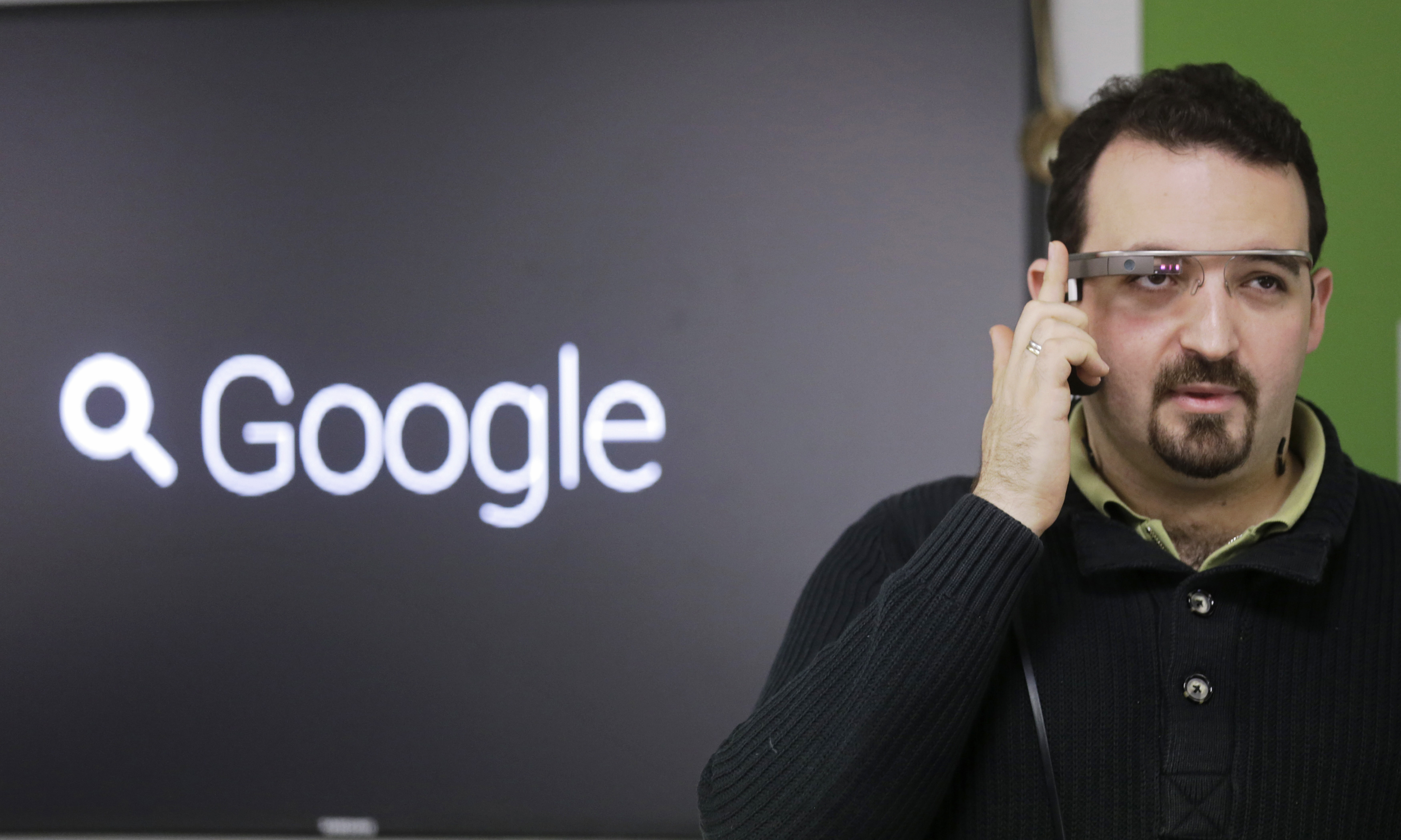 Developer Maximiliano Firtman wears a prototype Google Glass device in November 2013.