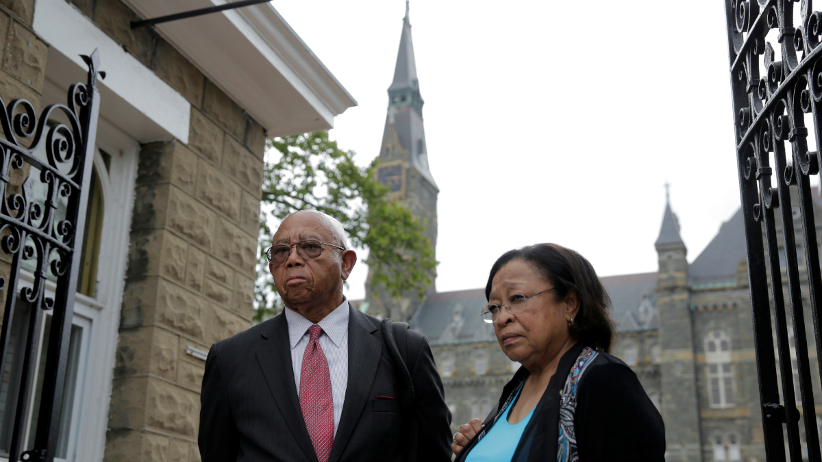 Joe Stewart and Patricia Bayonne-Johnson, both descendants of people sold as slaves by Georgetown University, visit the school on September 1, 2016 in Washington, D.C.