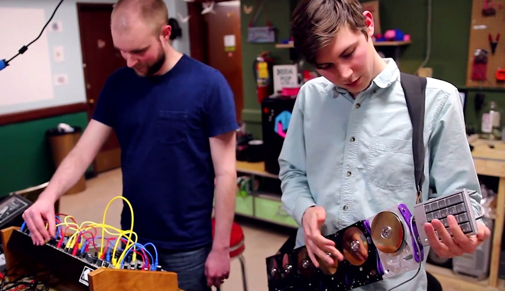 Members of Electric Waste Orchestra perform on their homemade instruments.