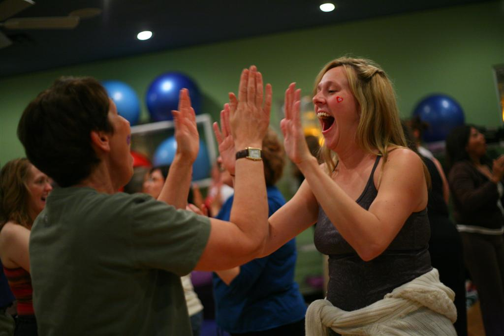 A woman laughs at a laughter Yoga class in Dallas