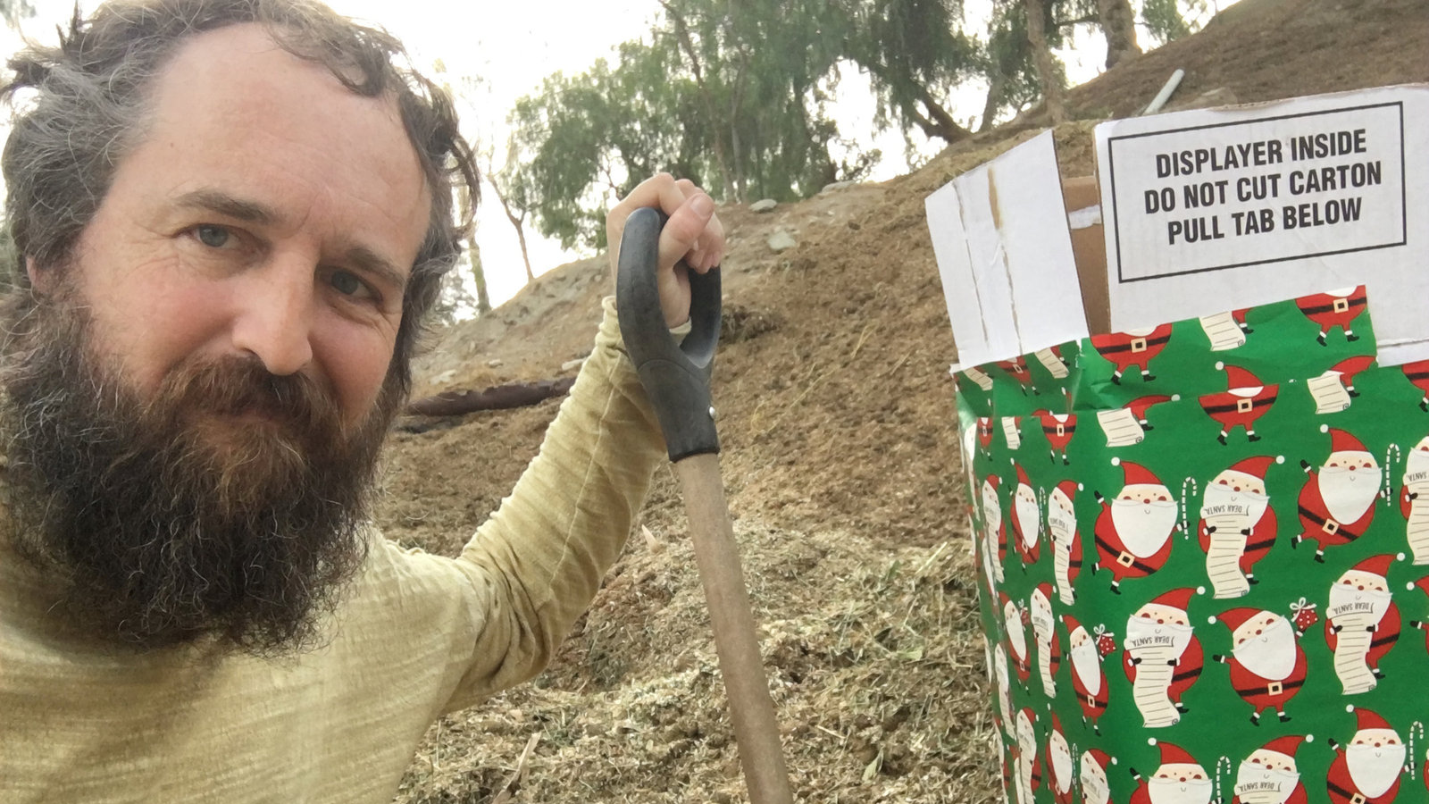 Robert Strong is seen next to a gift-wrapped box in this photo released by Robert Strong of Eagle Rock, California, on Dec. 25, 2017.