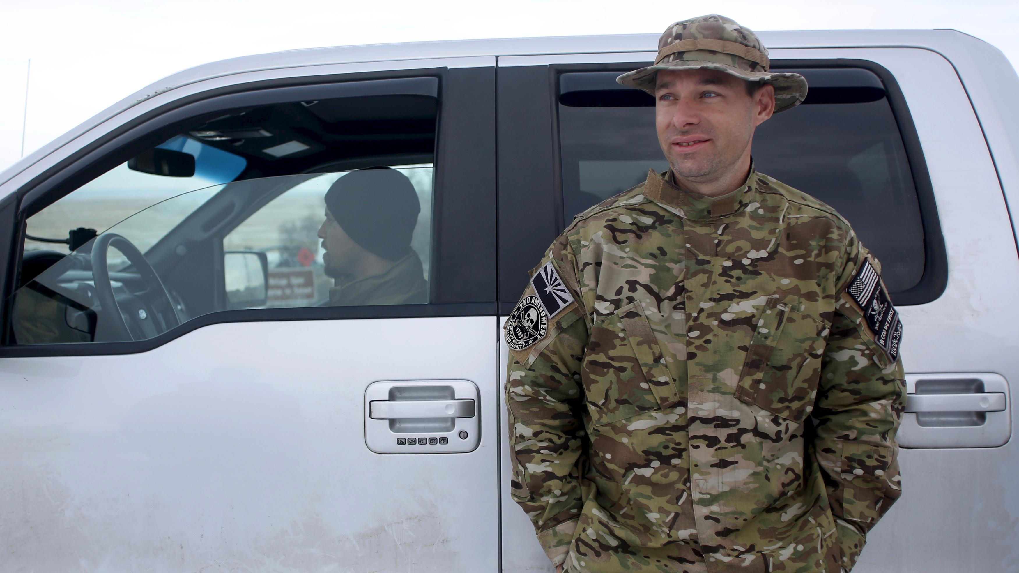 A militia member stands watch