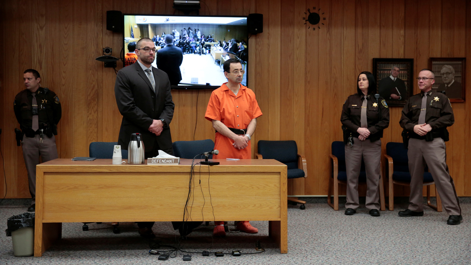 Larry Nassar, a former team USA Gymnastics doctor who pleaded guilty in November 2017 to sexual assault charges, and his defense attorney Matt Newburg stand during Nassar's sentencing hearing in the Eaton County Court in Charlotte, Michigan, Feb. 5, 2018.