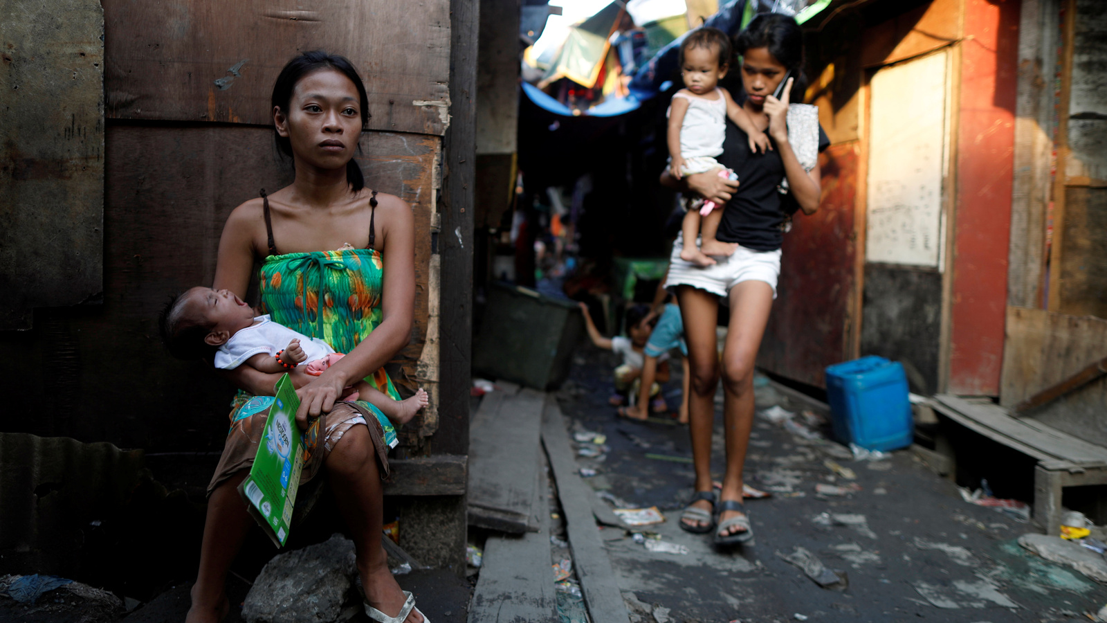 Residents are seen outside their shanties in Navotas, Metro Manila, Philippines, where Jazmine Durana lives, Oct. 28, 2017.