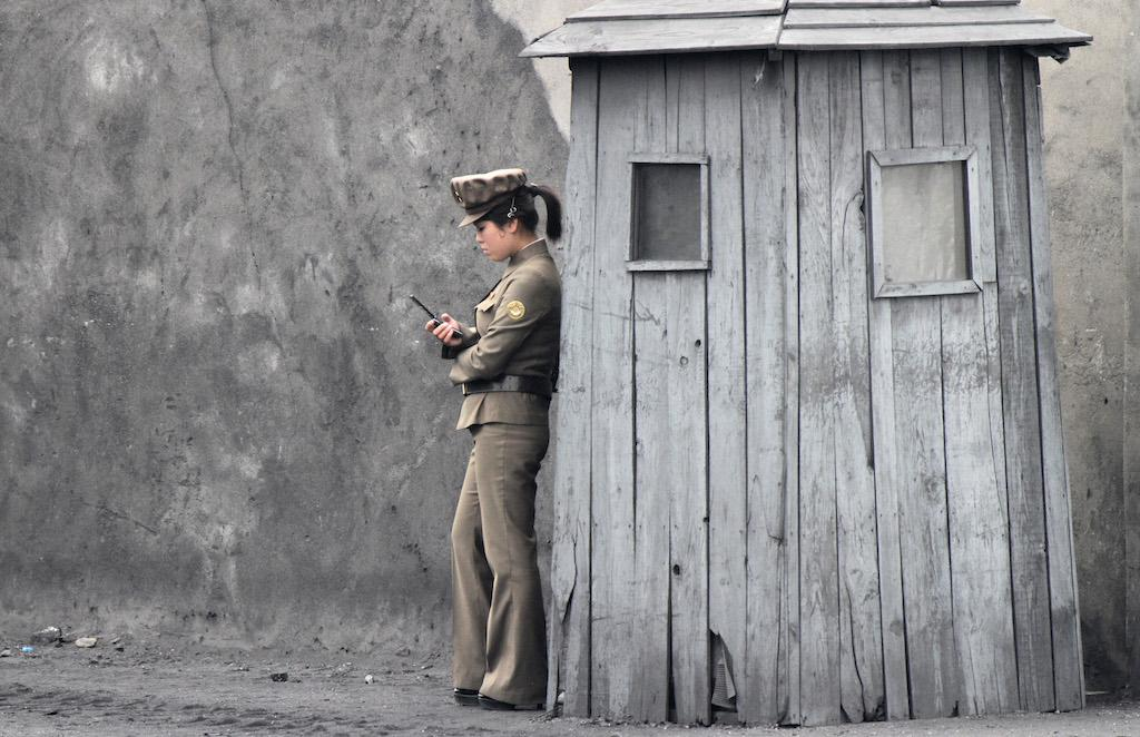 A North Korean soldier stands sentry on the banks of the Yalu River, June 1, 2014.