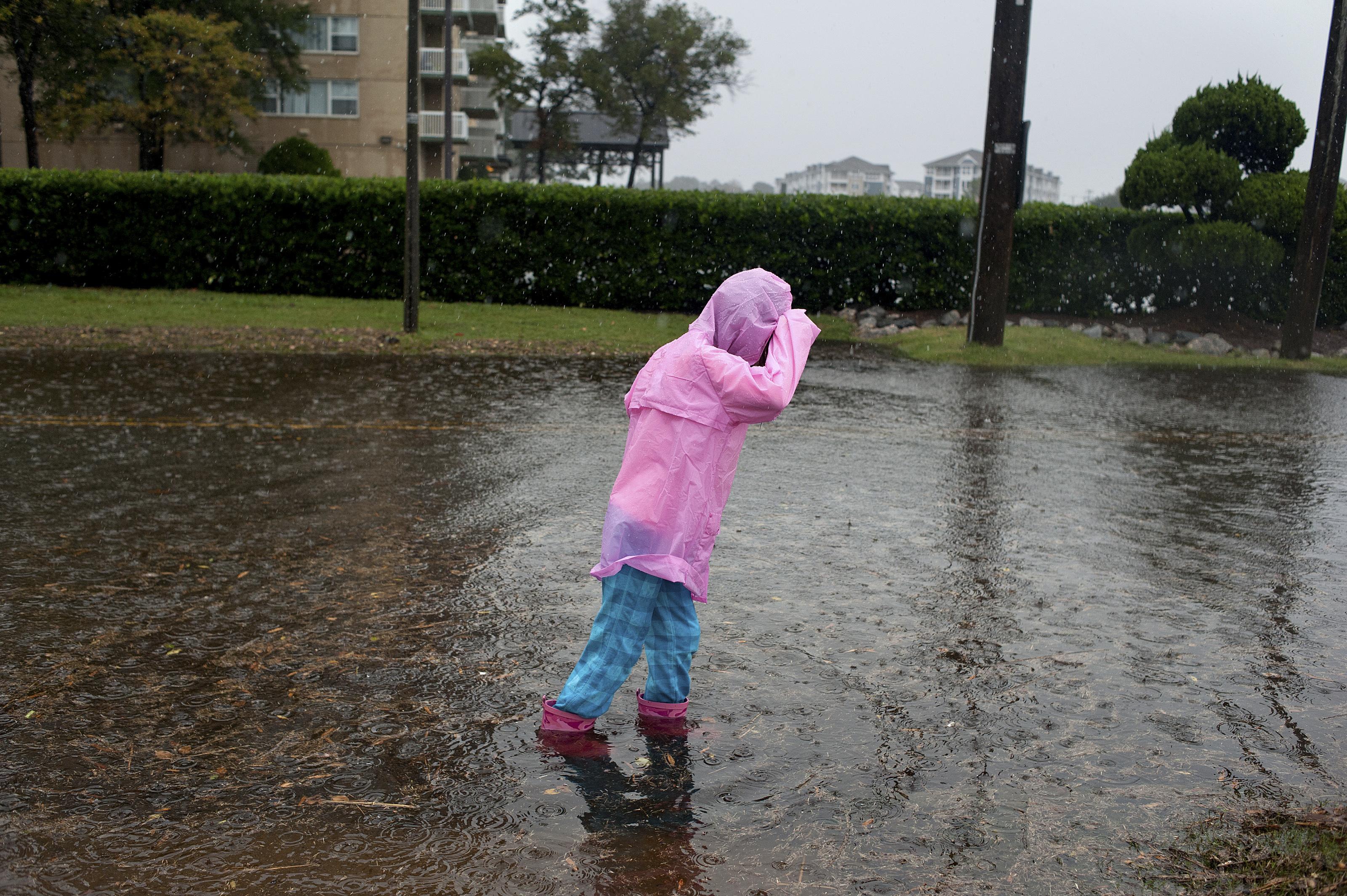 Girl walking through flooded street