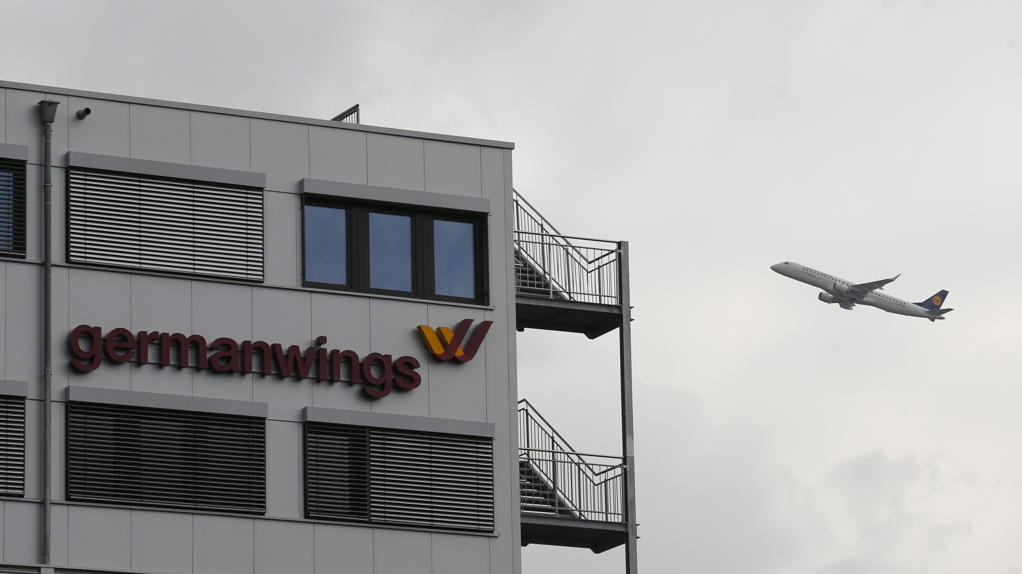 planeA Lufthansa aircraft flies past the headquarters of Germanwings during take-off from Cologne-Bonn airport.