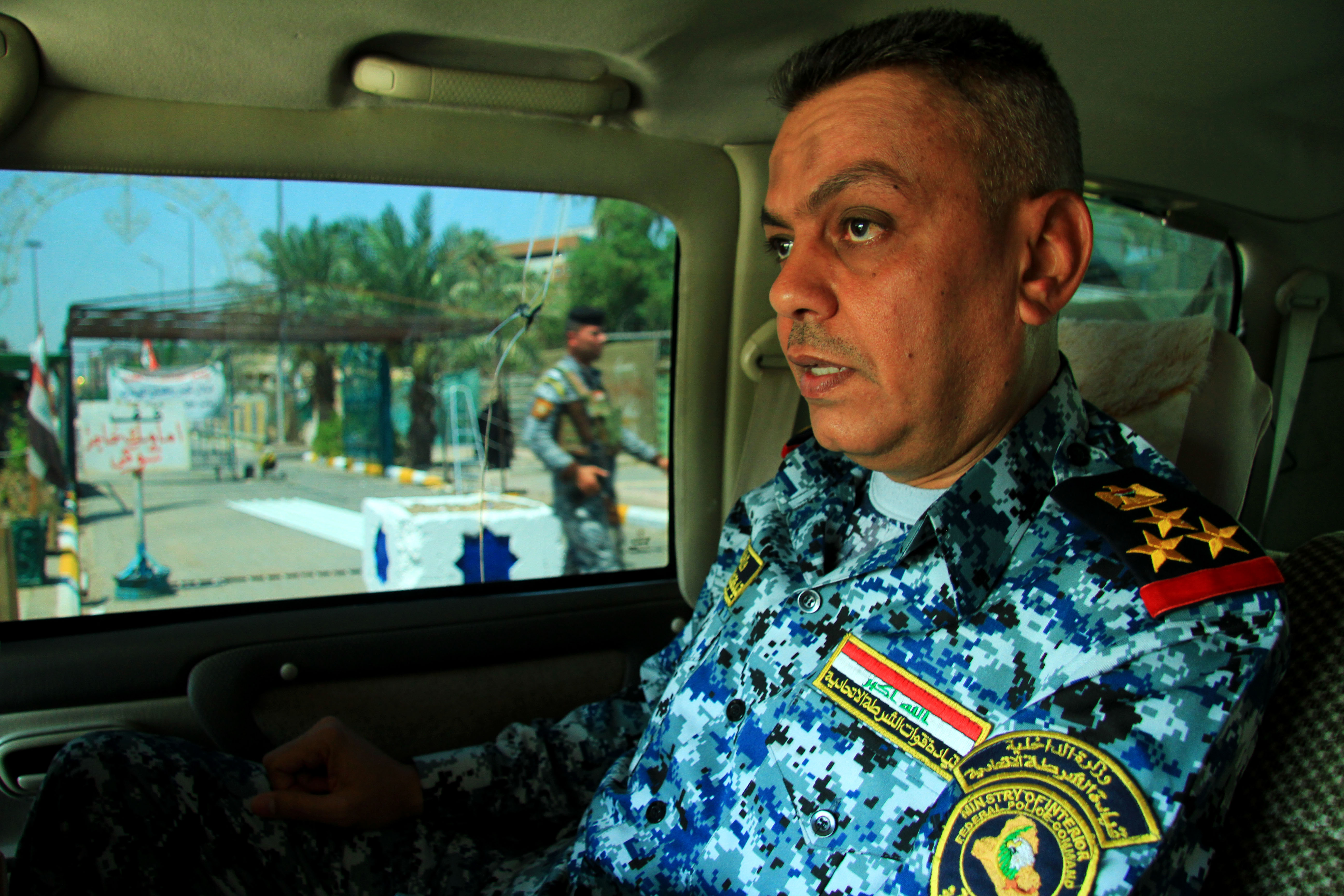 General Malik Maliki of the 8th division of Iraq's Federal Police out on patrol on the outskirts of the mostly Shia neighborhood of Khadamiya in north Baghdad. At a checkpoint not far from here, just hours before his visit, a suicide car bomb attack kille