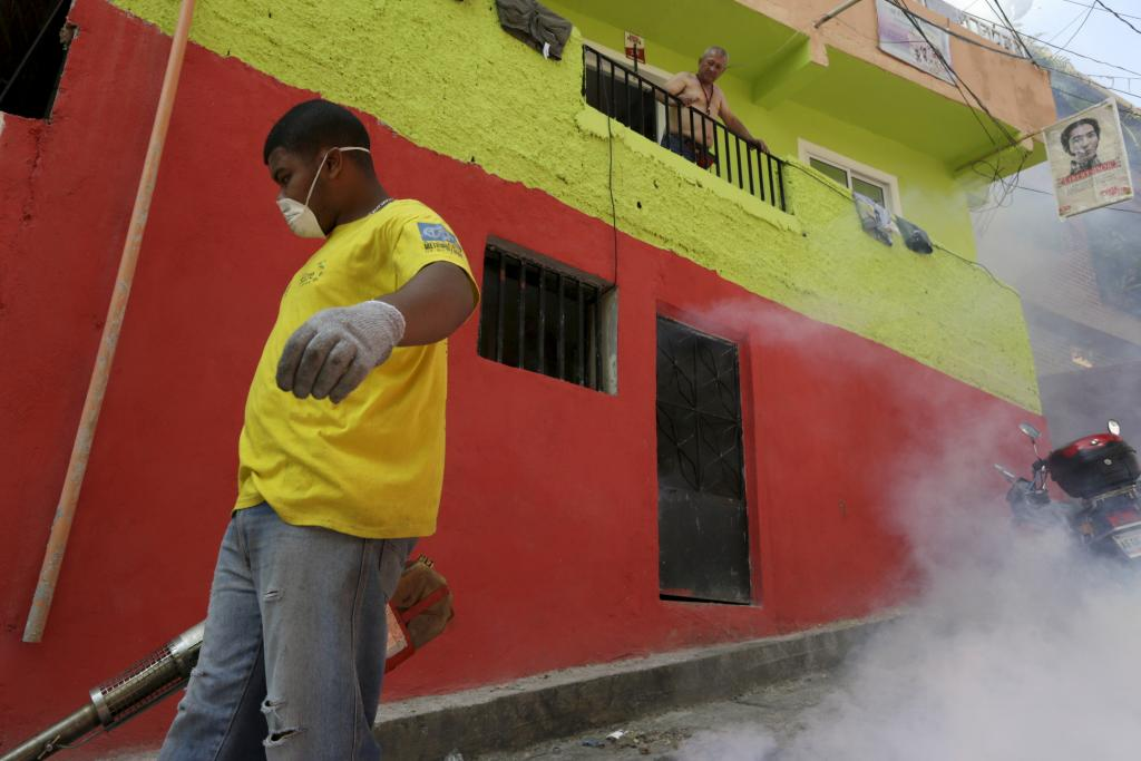 A municipal worker fumigates the Petare slum in Caracas to help control the spread of the mosquito-borne Zika virus, February 3, 2016.