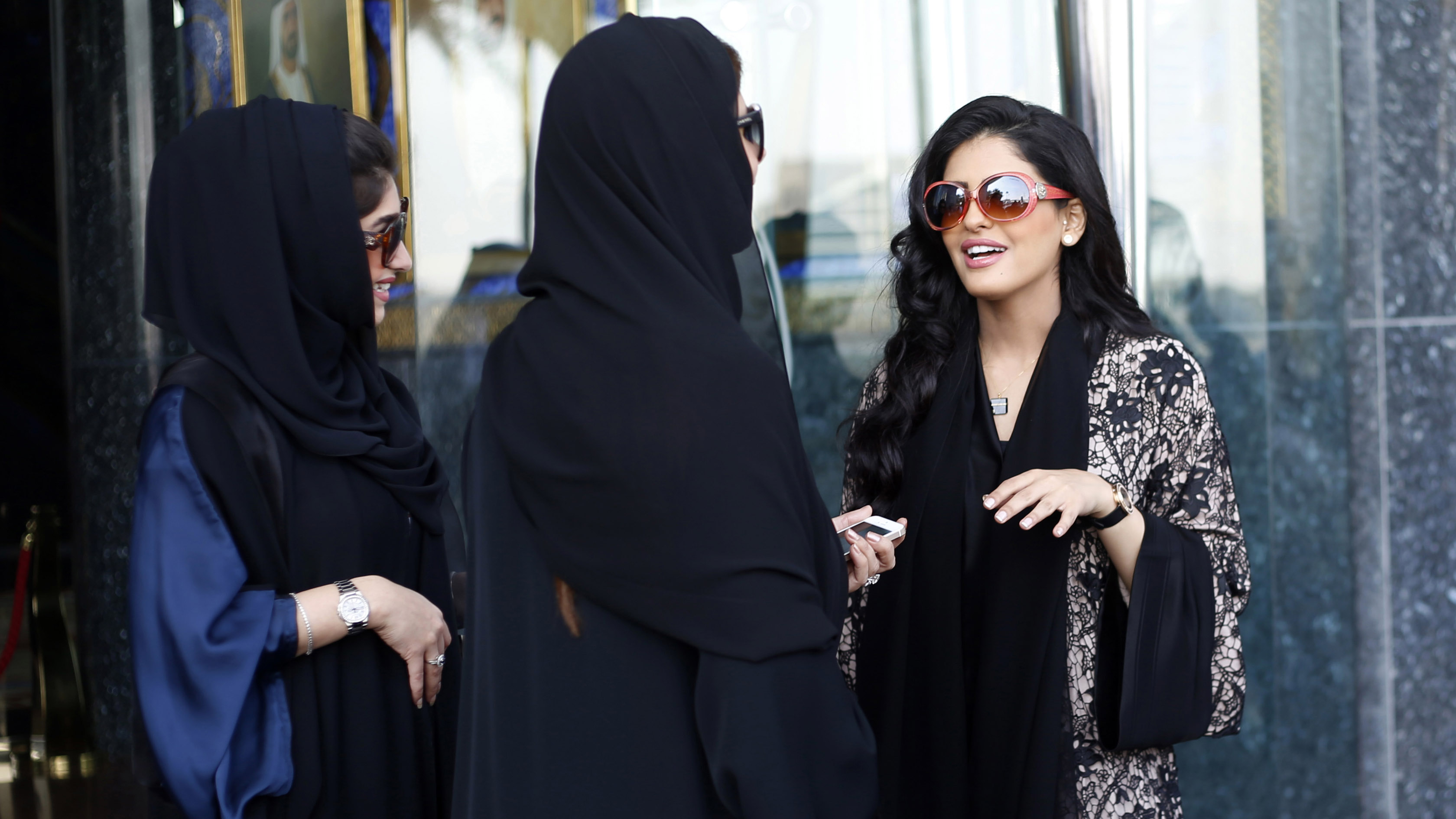 Princess Ameerah al-Taweel (R), chief executive of Saudi-based Time Entertainment Holding, speaks with women at Burj Al Arab hotel in Dubai March 9, 2014. While female company directors are still a rarity in the Middle East, the region's growing wealth, r