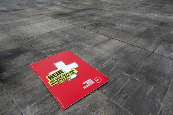"A poster against the ""mass immigration initiative"" of the Swiss Socalist Party SPS is seen on the Federal Square before a campaign in Bern."