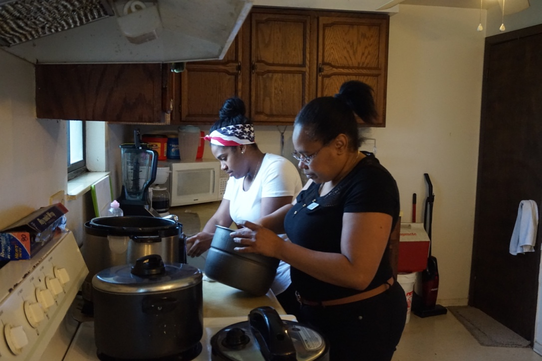 Heidy and Gregoria prepare dinner, rice and eggs