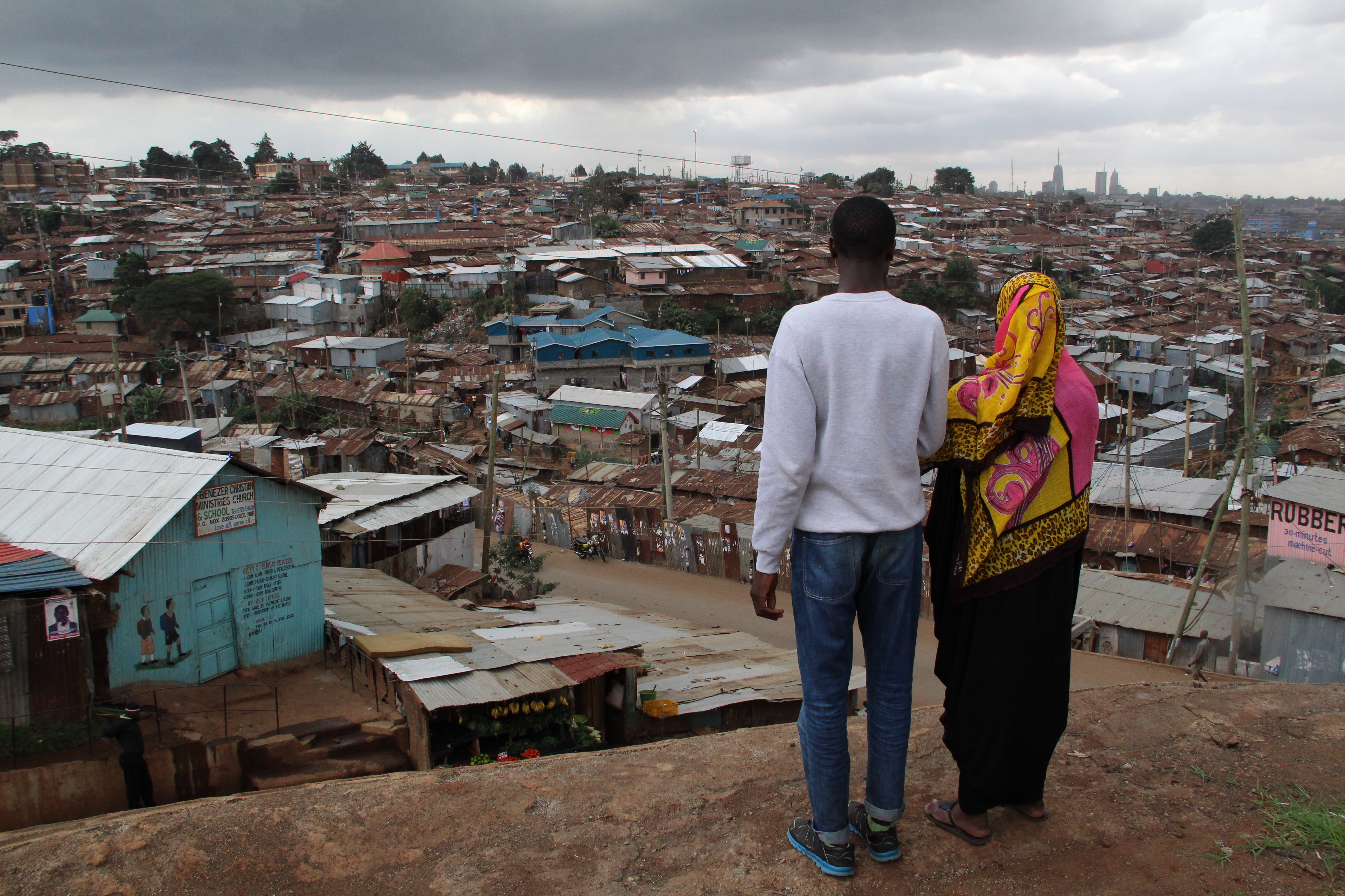 Ben and Salma are Kenyan students studying journalism at the Nairobi community news hub, Habari Kibra. They are looking out over their home town, Kibera, one of the largest slums in the world.