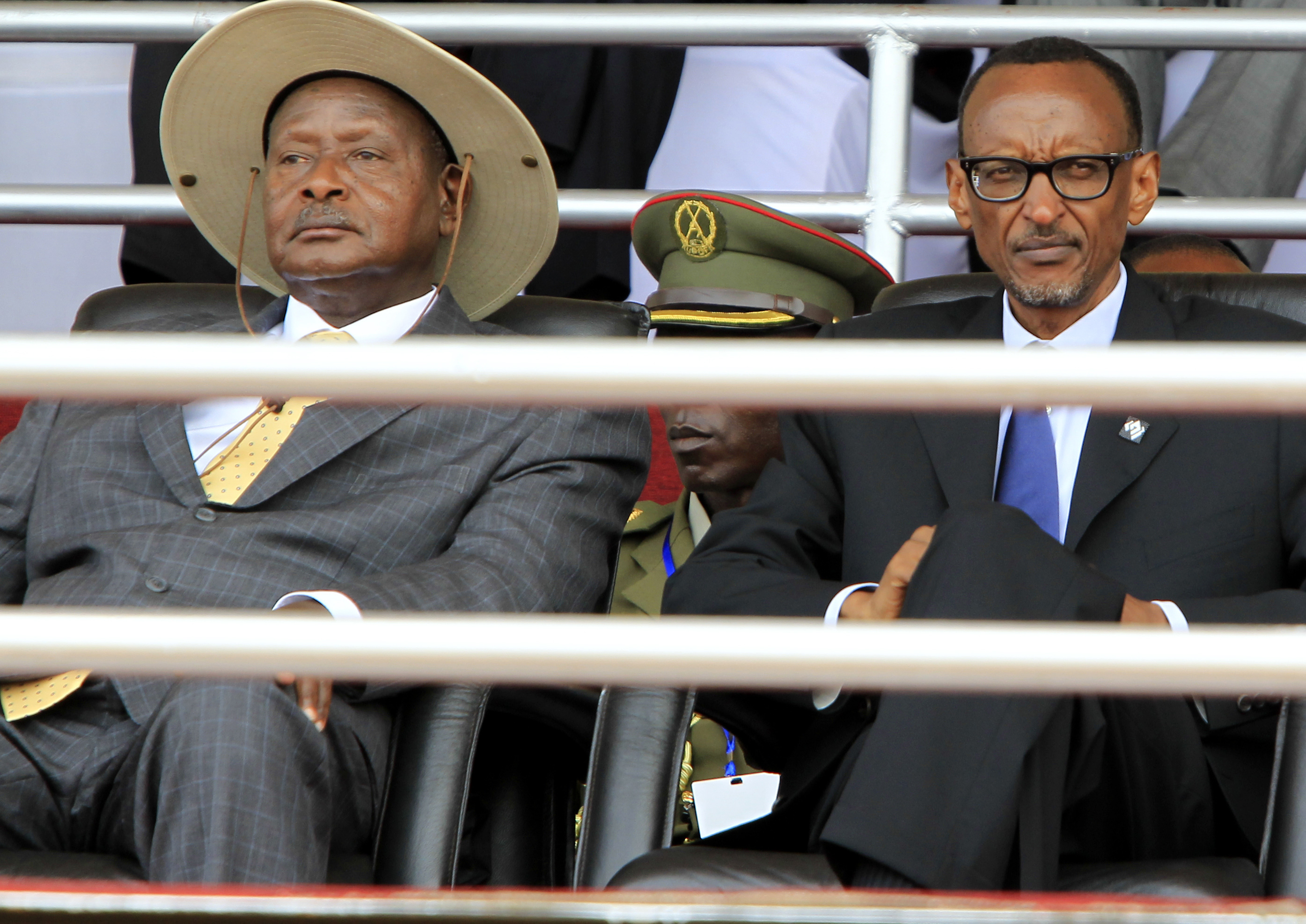 Rwandan President Paul Kagame (R) and his Ugandan counterpart Yoweri Museveni follow the proceedings of the 20th anniversary commemoration of the Rwandan genocide, in Kigali April 7, 2014. An estimated 800,000 people were killed in 100 days during the gen