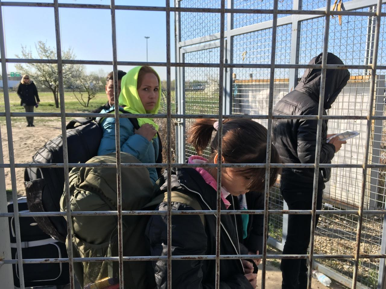 An Afghan family walks toward the Hungary-Serbia border on the day the new law takes effect.  They will live in a detention center until a decision is made on their claim.