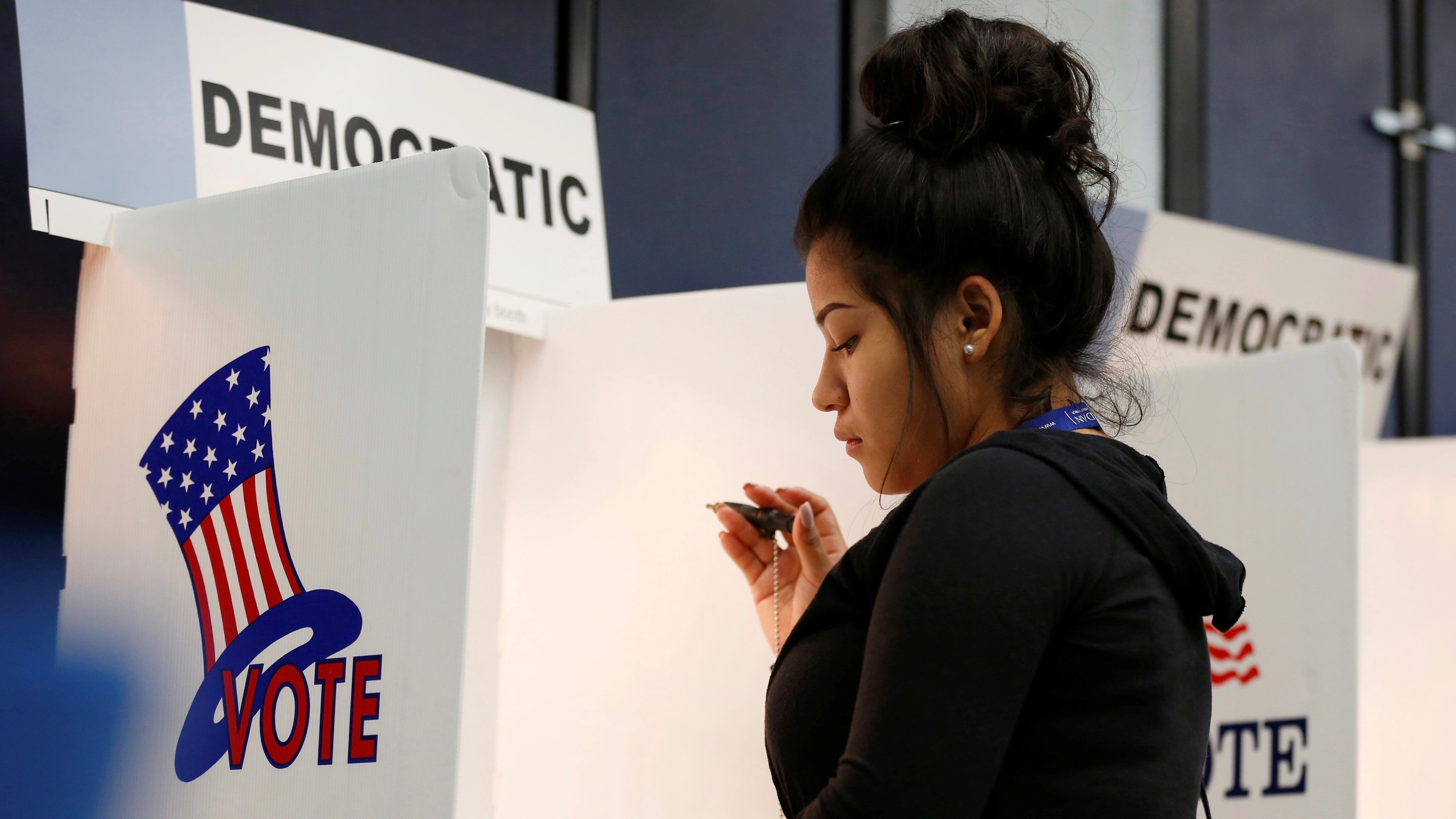 Kimberly Medina, 19, votes during the U.S. presidential primary election at Gates Street Elementary School in Los Angeles, California, on  June 7, 2016. Californians will vote Nov. 8 on a ballot measure that seeks to overturn a ban on bilingual education.