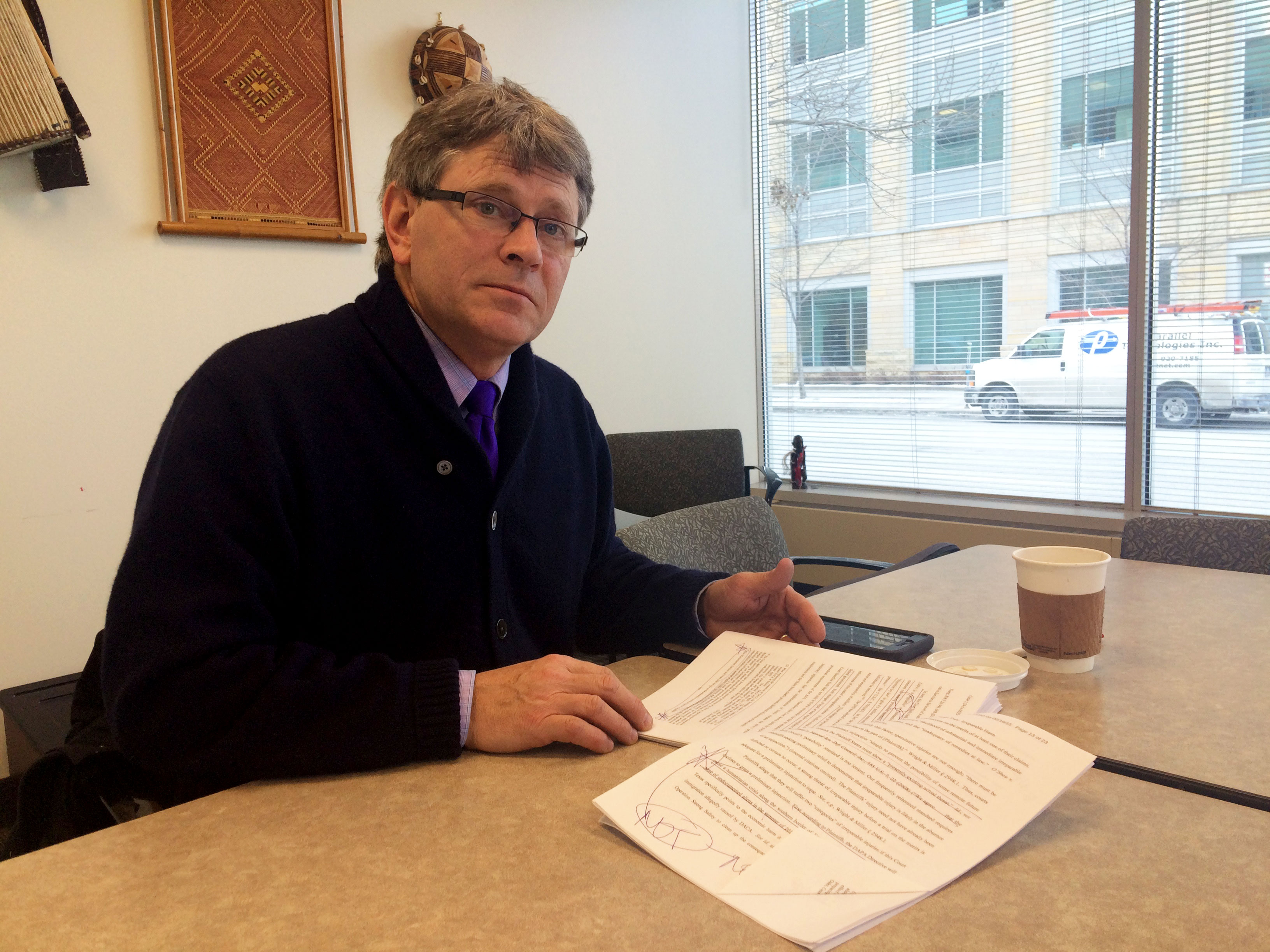 Prof. Virgil Wiebe reads the 123-page decision that halted President Obama's executive action on immigration on Monda.