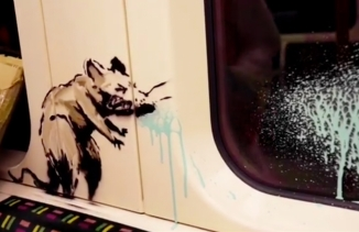 A stenciled rat appears to be sneezing.