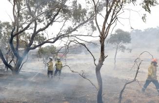 Firefighters control a spot fire near Bredbo, south of the Australian capital, Canberra, Feb. 2, 2020.