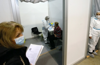 A medical worker gives a shot of the Chinese Sinopharm COVID-19 vaccine to a woman during the vaccination in Belgrade, Serbia, Feb. 17, 2021.