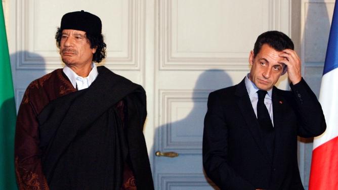 Former French President Nicolas Sarkozy (R) and former Libyan leader Muammar Gaddafi in 2007.