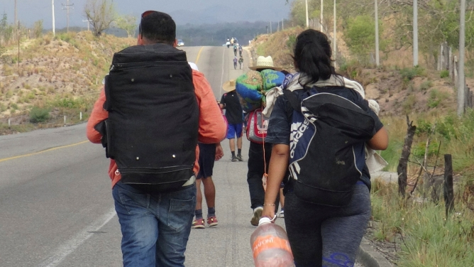 Central American migrants arrive walk along the roads of Ixtepec, Oaxaca, Mexico.