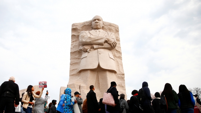 People walk around the monument of Rev. Martin Luther King Jr. in Washington.