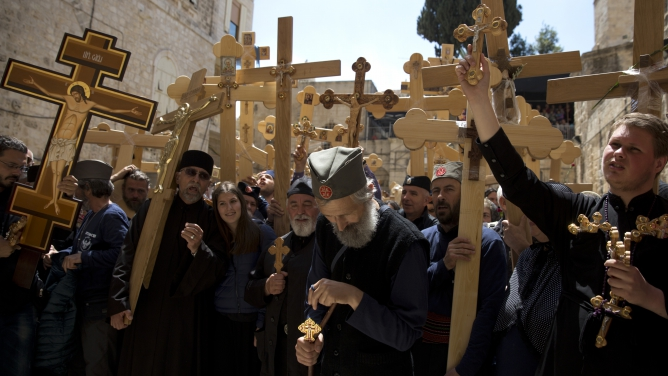 """Christian pilgrims from Eritrea are seen amongst the thousands of pilgrims that came from all over the world and carried wooden crosses along Via Dolorosa, or """"The Way of Sorrow."""""""