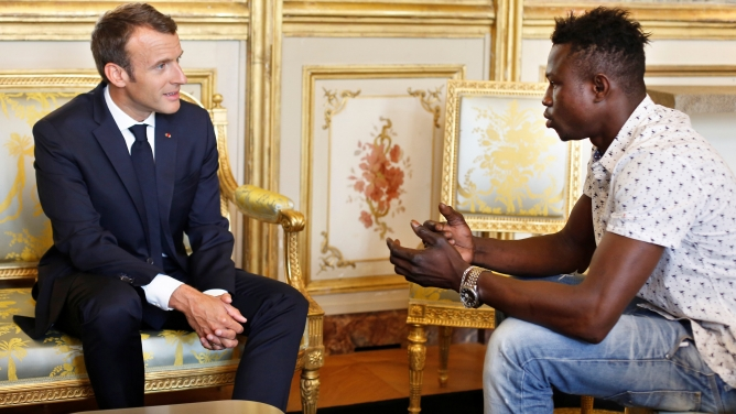 Emmanuel Macron, left, meets with Mamoudou Gassama