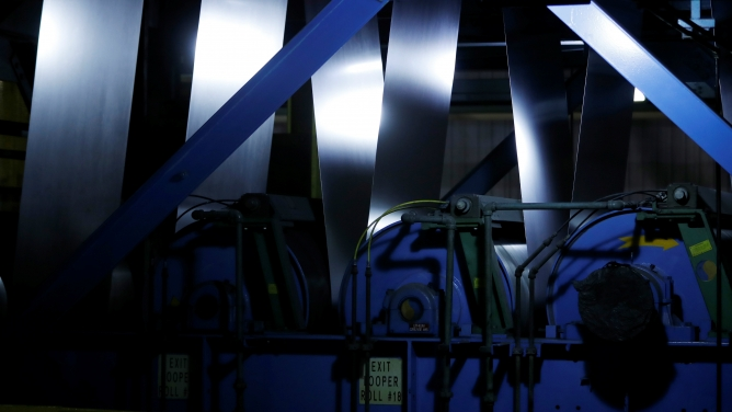 Steel goes through machinery at the ArcelorMittal Dofasco steel plant in Hamilton, Ontario, Canada, March 13, 2018.