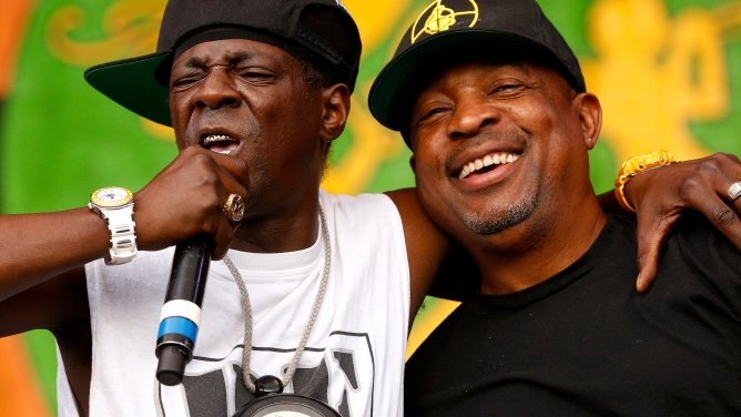 Flavor Flav (left) and Chuck D (right), of Public Enemy, perform during the New Orleans Jazz and Heritage Festival in 2014.