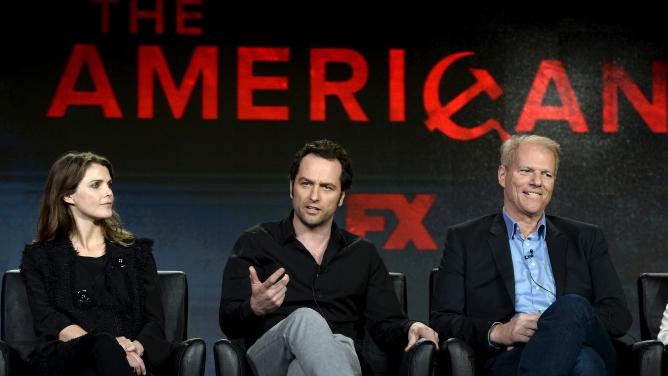 Keri Russell, left, Matthew Rhys, center, and Noah Emmerich