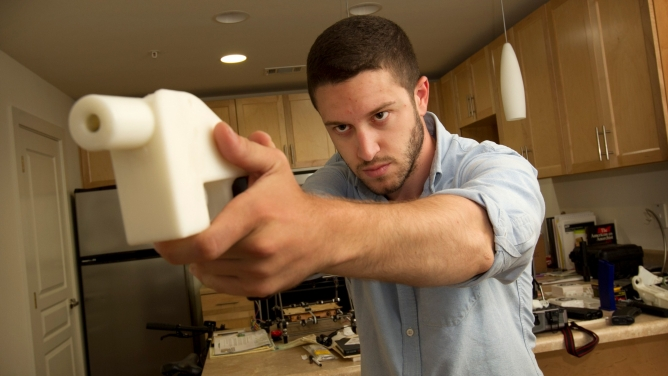 Cody Wilson shows off his 3D-printed handgun at his home in Austin, TX, 2013.