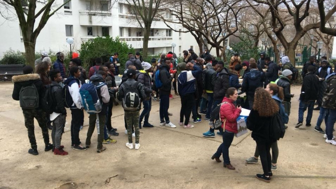 Homeless migrant teenagers meet twice a week in this public park in northern Paris for a hot meal brought by volunteers.