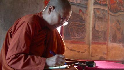Dhammananda studying